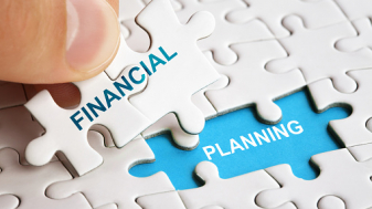 Hand holding piece of puzzle with words Financial Planning.