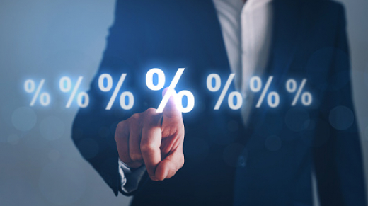 Businessman pointing digital percentage symbol. Interest rate financial and mortgage rates.