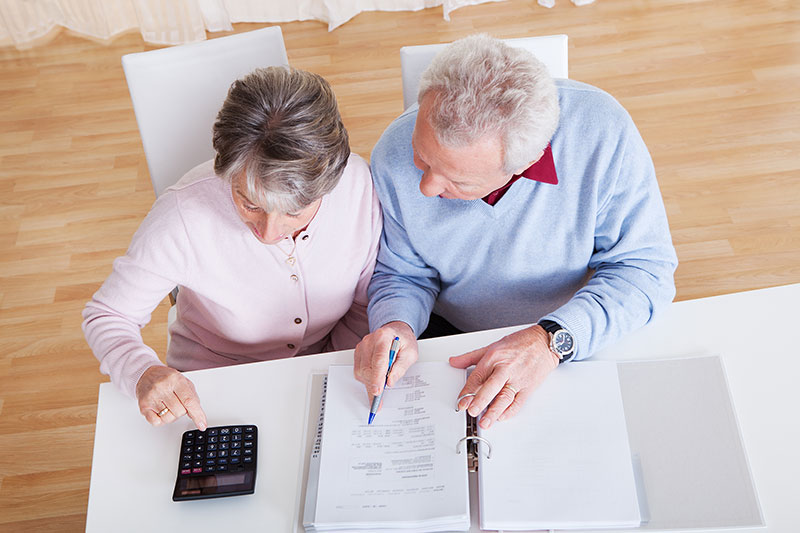 Older couple looking over paperwork