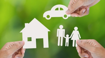 paper cutouts of a house, a car and a family to represent assets